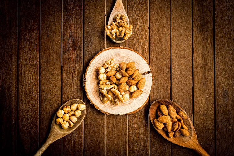 Nuts and almonds on a wooden table