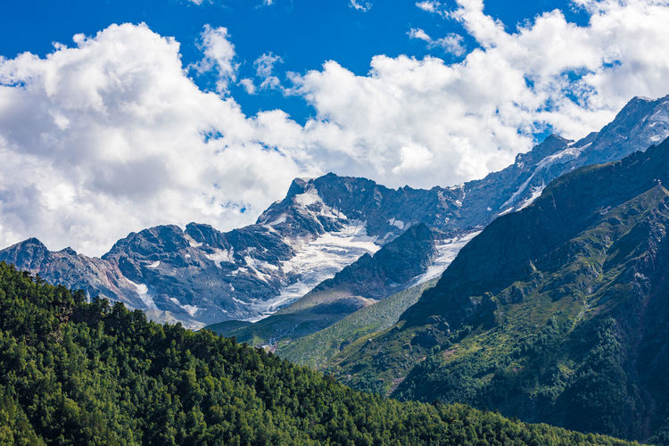 Landscape of snow-capped mountains and rocks