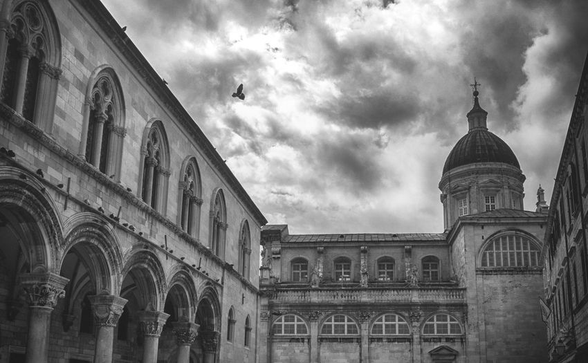 Old City, Dubrovnik. Blackandwhite City Architecture Dubrovnik, Croatia Buildings Street Photography Pigeon Nature Monochrome Sky Clouds Travel Destinations Historical Building Outdoors Travel Grey Arch Architecture_collection Birds Town Tower Culture Croatia EyeEm Best Shots