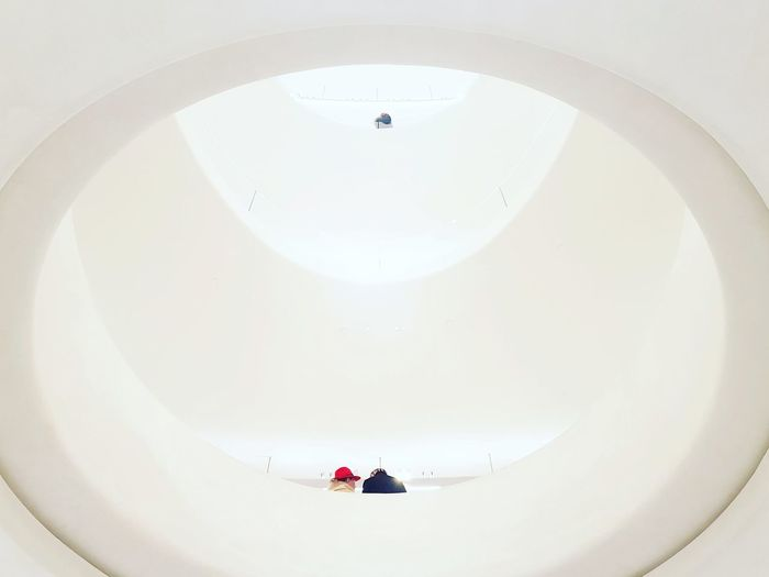 White Background White Color White Red Hat Red Hat Minimalism Minimalobsession Minimalist Architecture Minimal Minimalist Photography  Minimalmood Week On Eyeem EyeEm Selects Streetphotography Full Length High Angle View Spiral Staircase Spiral Steps And Staircases