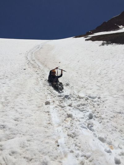 Low angle view of man sliding on snowcapped mountain