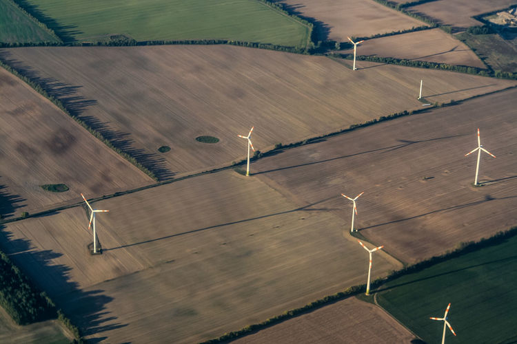 Aerial view of windmills on landscape