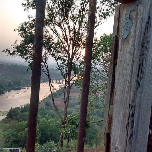 A view through a window of a rusty old broken house on a mountain top..the house actually had a big banyan tree in it.....Nature Window RuralExploration Instagood India Instamood Instalike Instagram Natural Natgeo Traveler Travel Photographer Amazing Amazingclick BBC BBCTravel View Viewthroughwindow Old Abandoned Leftalone Justhitlike Doubletaponphoto