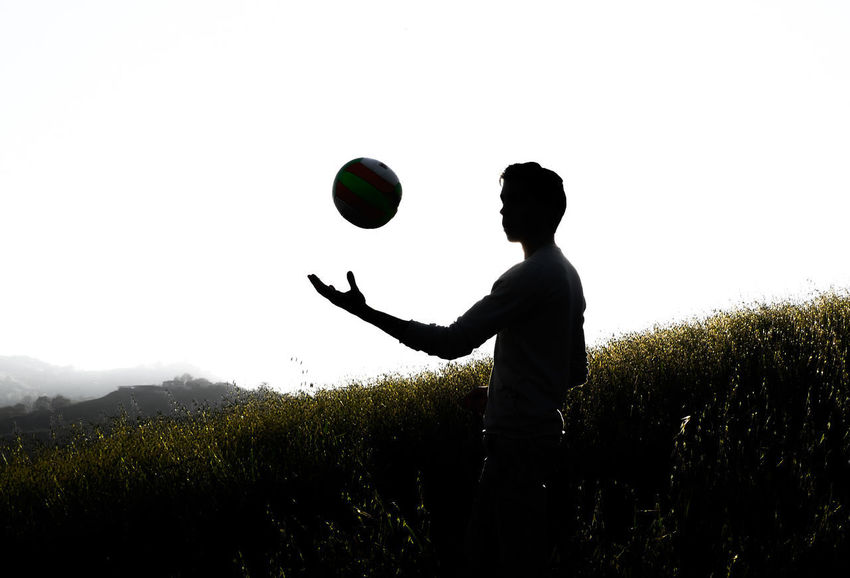 our ball need a pump :-) Real People One Person Sky Men Field Lifestyles Leisure Activity Plant Side View Nature Land Three Quarter Length Standing Ball Playing Beauty In Nature Silhouette Mid-air Throwing  Outdoors Juggling Modena Blackandwhite Mountain ON AIR