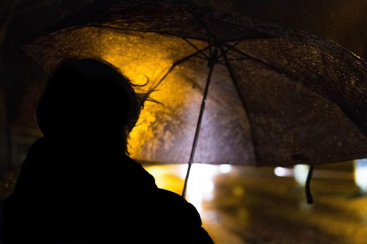 In the rain Umbrella Illuminated One Person Silhouette Lifestyles Leisure Activity Night Standing EyeEm Streets Eyeem Streetphotography Rain Rainy Days Rainy Season Alone Loneliness