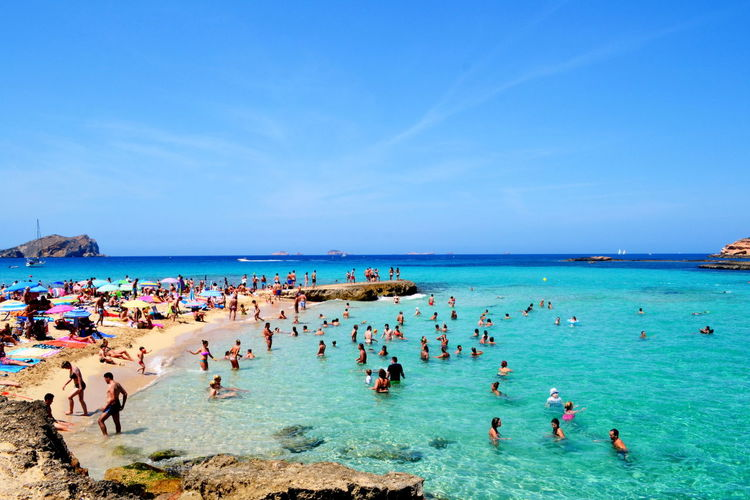 Beach Beauty In Nature Blue Clear Sky Day Horizon Over Water Large Group Of People Leisure Activity Lifestyles Men Nature Outdoors People Relaxation Scenics Sea Sky Summer Sunny Tourist Resort Travel Destinations Vacations Vivo Per La Storia Water Women