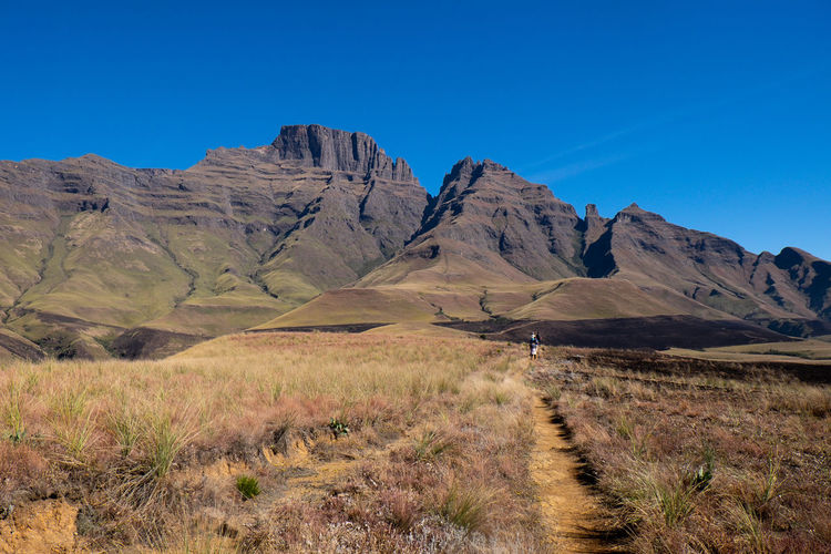 Hiking  with friends en route to champagne castle peak , drakensberg , south africa
