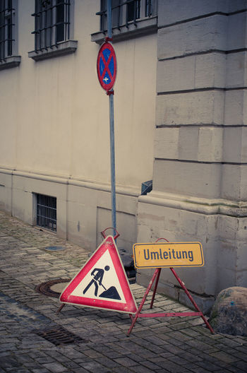 Construction site with warning signs in German language Architecture Construction Site Construction Sign German German Language Architecture Built Structure Close-up Communication Danger Day Exploration Guidance No People Outdoors Pedestrian Crossing Sign Road Sign Safety Sign Symbol Text Tourism Triangle Shape Urban Warning Warning Sign