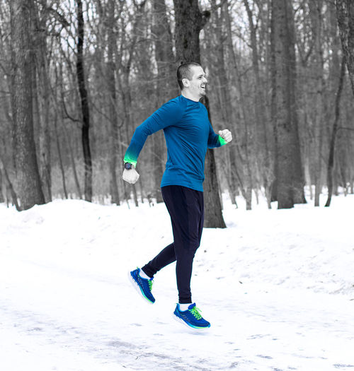 Sporty man jumping or running in winter forest. Outdoor activity. Winter Snow One Person Full Length Tree Cold Temperature Lifestyles Motion Leisure Activity Sport Day Real People Plant Clothing Land Nature Bare Tree Field Warm Clothing Outdoors Runner, Running Outdoor Activity Runner