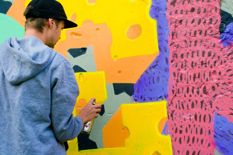 Casual Clothing Colorful Graffiti Graffiti Art Graffiti Wall Guy Hands At Work Modern Modern Art Mural Mural Art Outdoor Photography Outdoors Painting People And Places People Of EyeEm Street Street Photography Yellow Young Youth Of Today