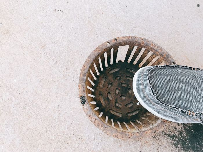 High angle view of manhole on wall