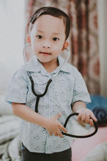 Portrait Of Cute Boy Playing