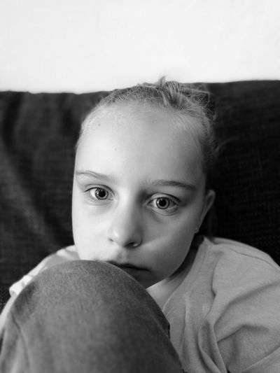 Close-up portrait of innocent girl at home