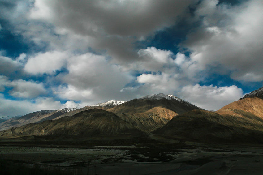 light and shadow Alone Time Along The Way Traveling Beauty In Nature Cloud - Sky Day Landscape Mountain Mountain Range Nature No People Outdoors Range Scenery Scenics Shadow Sky Snow Tranquil Scene Tranquility Travel Destinations Way