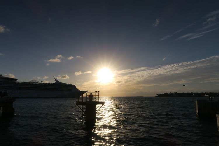 Mallory Square Beauty In Nature Bright Cloud - Sky Horizon Over Water Keywest Lens Flare Mode Of Transportation Nature Nautical Vessel No People Outdoors Reflection Scenics - Nature Sea Silhouette Sky Sun Sunlight Sunset Tranquil Scene Tranquility Transportation Water Waterfront