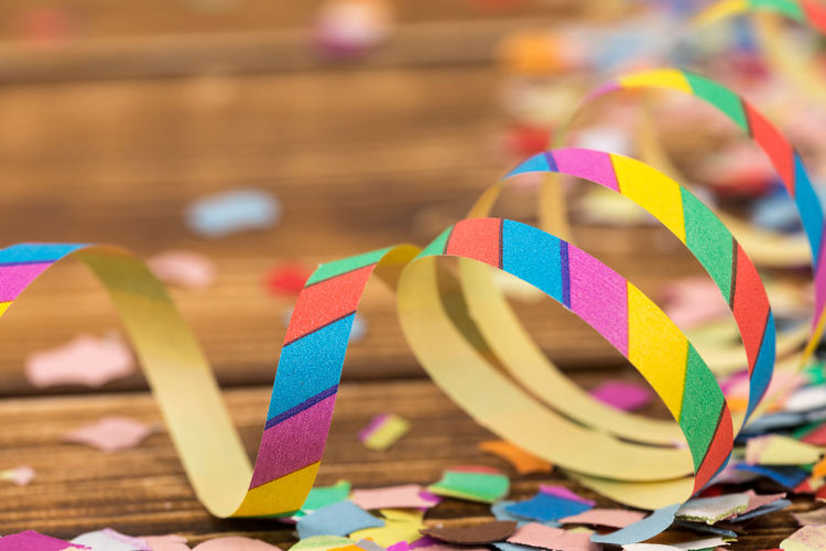 Close-up of colorful confetti and spiral decoration on table