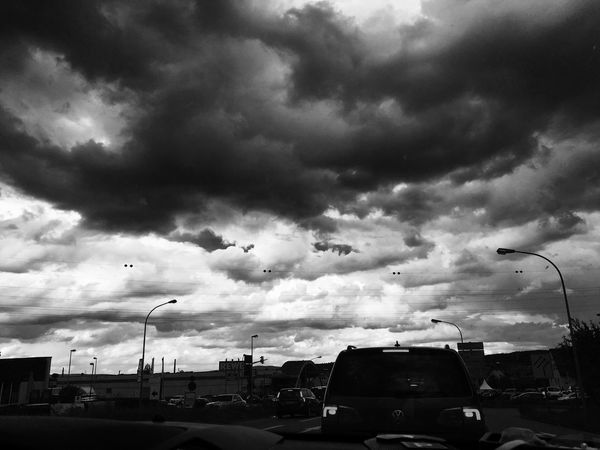Cloud - Sky Car Transportation Sky Mode Of Transport Land Vehicle Architecture Built Structure Day Outdoors Street Light City Life Road City Building Exterior No People Animal Themes Wolken EyeEmNewHere Black And White Friday
