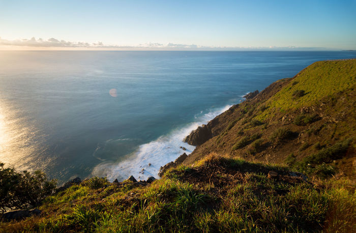 Beauty In Nature Blue Sky Cliff Coast Grass Long Exposure Motion Nature Outdoors Sea Sunny Day Sunrise Water Waves