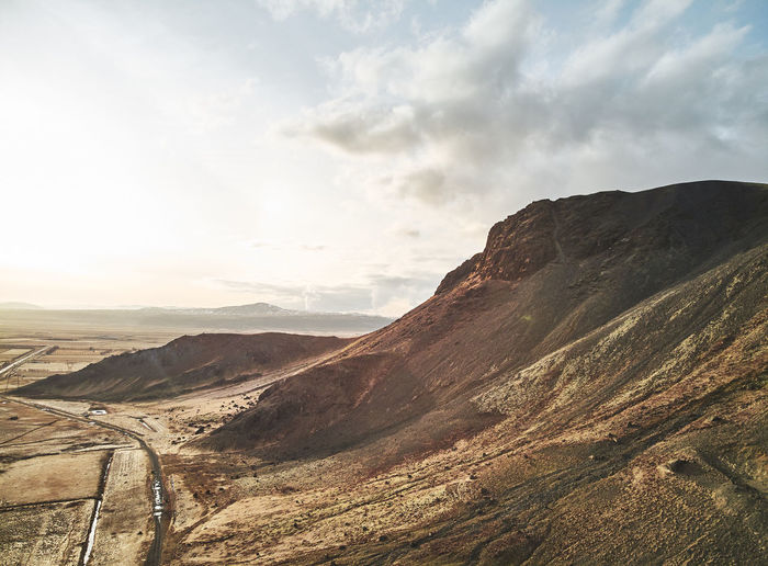 Scenics - Nature Sky Landscape Cloud - Sky Beauty In Nature Environment Mountain Tranquil Scene Tranquility Non-urban Scene Mountain Range Nature Road Transportation No People Remote Day Idyllic Mountain Road Travel Outdoors Arid Climate Climate First Eyeem Photo