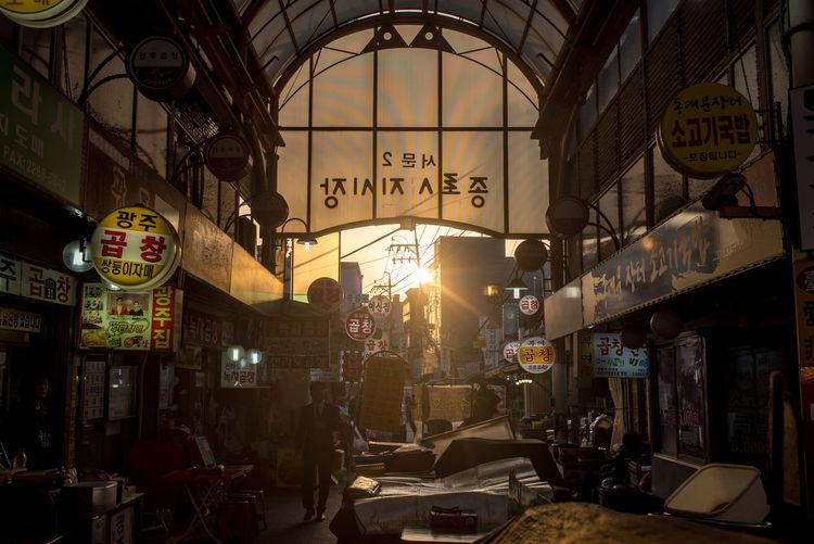 Illuminated street market in city