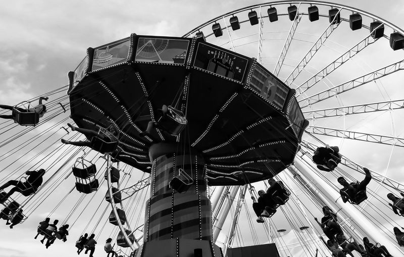 Amusement park by the lake Amusement Park Amusement Park Ride Arts Culture And Entertainment Black And White Carousel Day Enjoyment Ferris Wheel Large Group Of People Leisure Activity Low Angle View Men Outdoors People Real People Sky