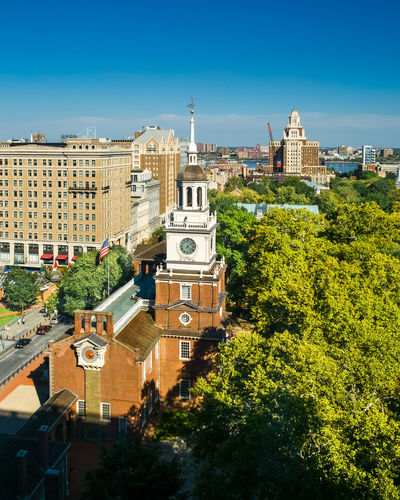 A view of Independence Hall, in Philadelphia, from above. The Declaration of Independence was signed here on July 4, 1776. Independence National Park Philadelphia Architecture Blue Building Exterior Built Structure City Cityscape Clock Tower Day High Angle View Independence Hall Outdoors Sky Tower