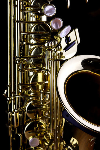 Music Instrument Alto Saxophone, Saxophone Isolated on black Musical Instrument Music Brass Instrument  Arts Culture And Entertainment Brass Metal Saxophone Close-up Wind Instrument Trumpet Jazz Music Musical Equipment No People Indoors  Food And Drink Studio Shot Drink Equipment Coffee Gold Colored