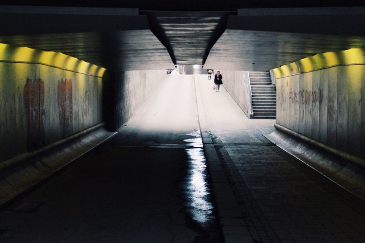 Woman Entering Tunnel