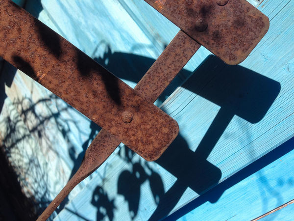 Rusty chair Chair Rust Blue Close-up Day Daylight High Angle View Metal Old Rusty Shadow Shadows And Light Sunlight Weathered Wood - Material