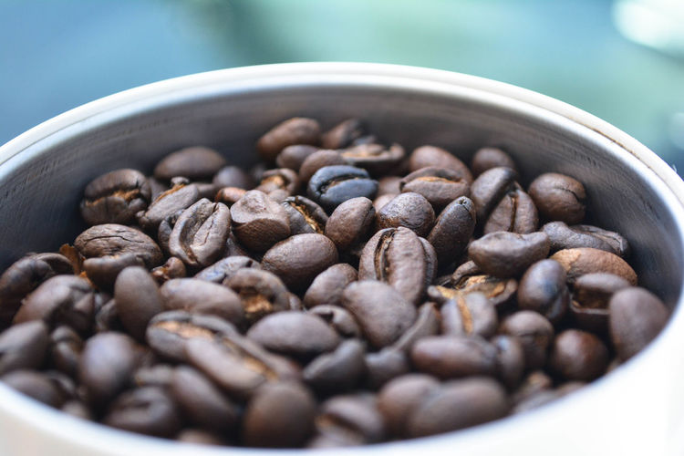 High angle view of roasted coffee beans in bowl