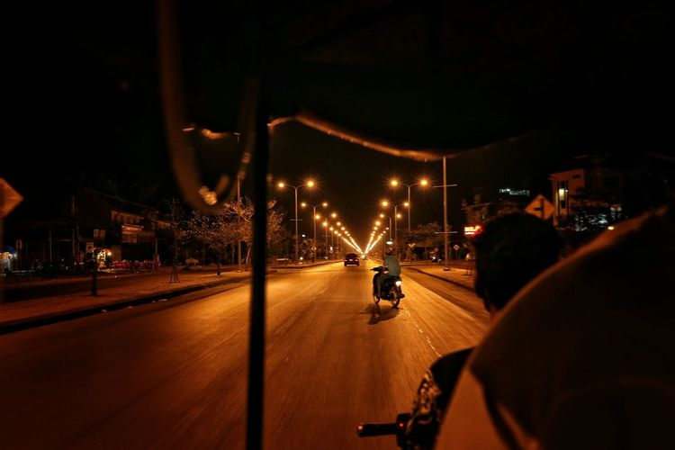Empty Road Along Lit Street Lights At Night