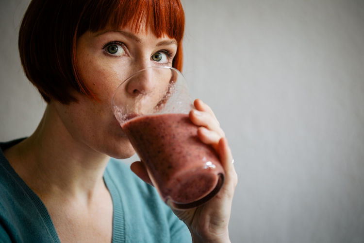 Adult Close-up Day Drink Drinking Freshness Healthy Eating Holding Horizontal Looking At Camera One Person One Woman Only Only Women People Person Portrait Redhead Refreshment Smoothie, Woman Young Adult