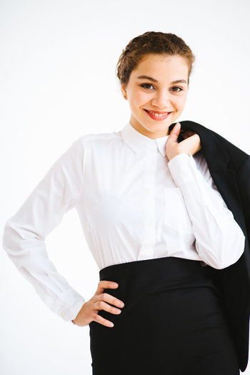 Portrait of businesswoman smiling over white background