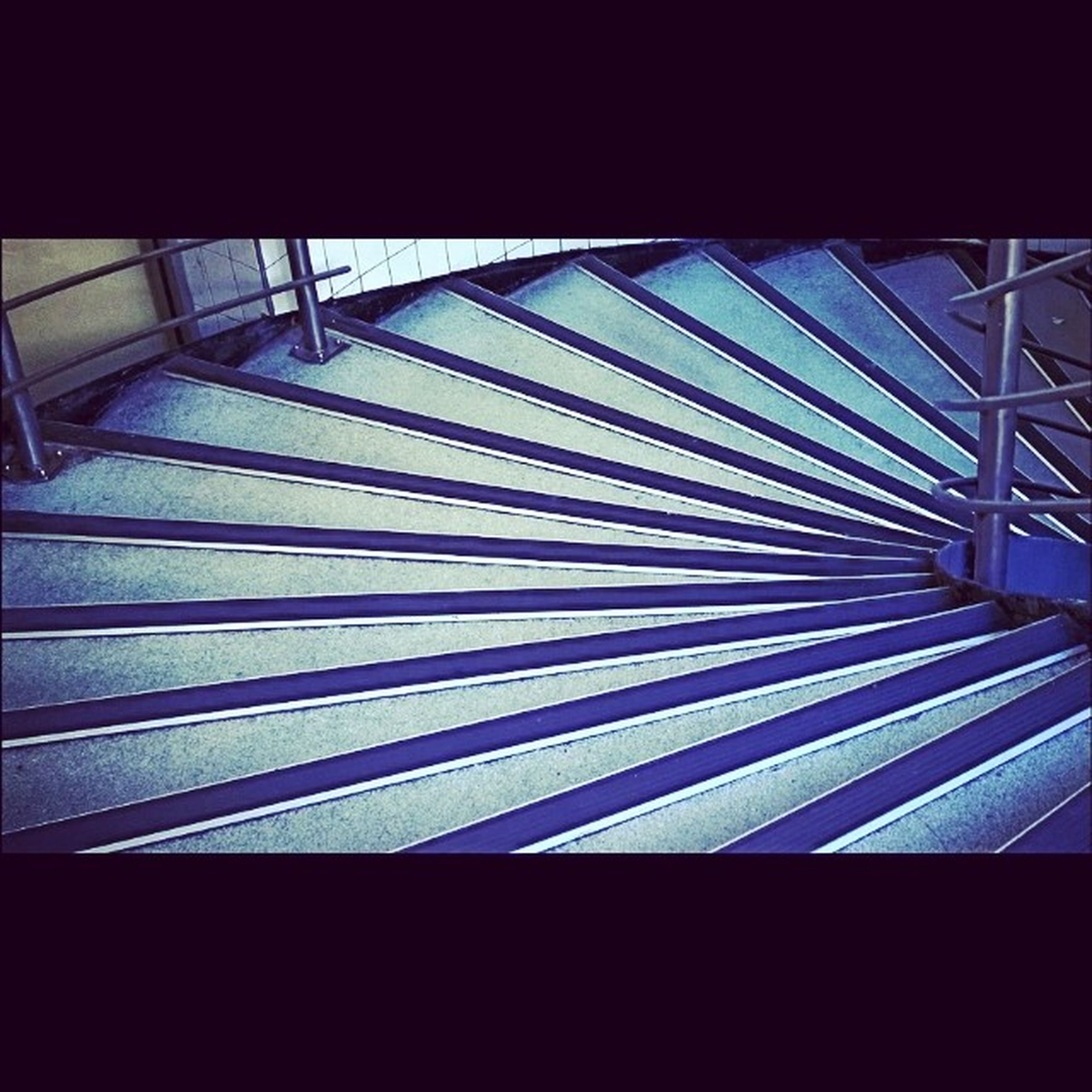 architecture, built structure, low angle view, indoors, railing, building exterior, pattern, building, modern, staircase, steps, steps and staircases, glass - material, window, no people, sunlight, day, city, metal, shadow
