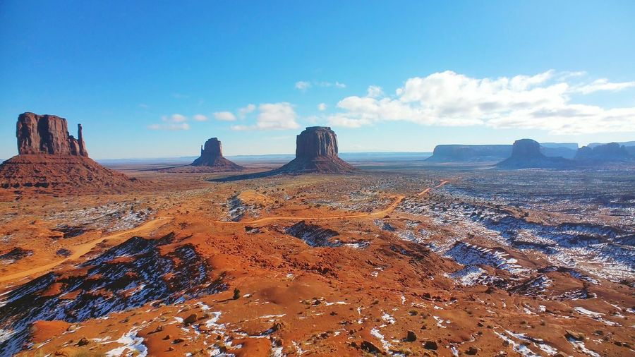 Scenic view of monument valley against sky