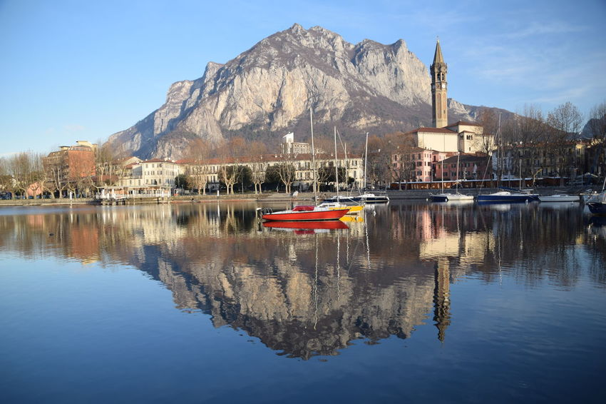 Lecco Morning Lario Stefanovalsecchi Tranquility Peace Peaceful Relaxing Mirror Reflection Reflection Mountain Water Waterfront Architecture Built Structure Building Exterior Nautical Vessel Tranquility Mountain Range No People Beauty In Nature Scenics Sunlight Lake Nature Sky Outdoors Day Clear Sky Moored The Graphic City Shades Of Winter