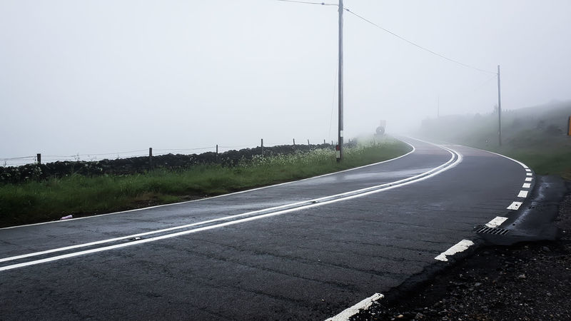 Road to the clouds Winding Road Road Sign Road Curve Highway Street Sky Mountain Road Asphalt Empty Road Foggy vanishing point