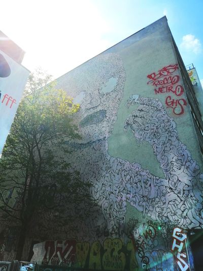 This master piece had to be shot. Sky Close-up Street Art Aerosol Can Graffiti Non-western Script Ivy Mural Capital Letter Creeper Vandalism Art Fresco Signboard Information Information Sign Spray Paint