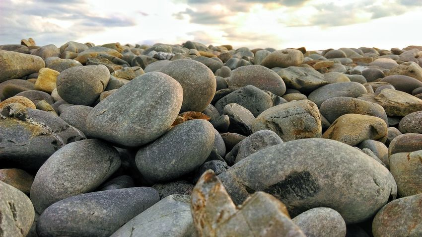 Rocky Shore Close-up Beauty In Nature Shore Rocks Beach Beach Photography Focus Ocean Clouds And Sky Rocky Shoreline Sunset Nature