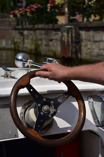 Man steering a ship in Gent, Belgium Boat Body Part Day Finger Focus On Foreground Hand Holding Human Body Part Human Finger Human Hand Human Limb Leisure Activity Lifestyles Marine Men One Person Outdoors Real People Ship Steering Wheel Steering Wheel Ship Unrecognizable Person Water Waterfront Wooden Steering Wheel