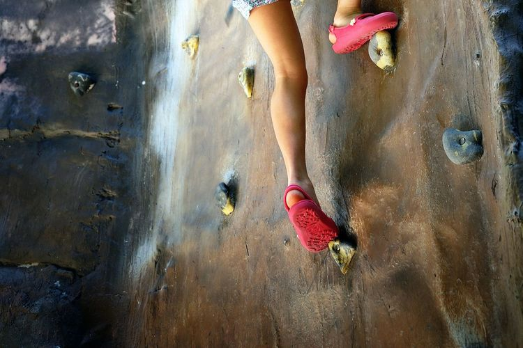 Low Section Of Girl Climbing Rock