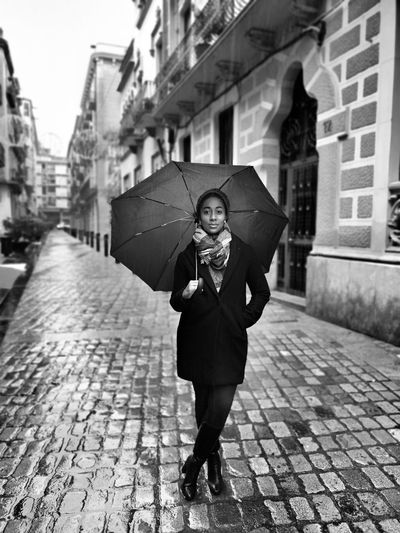 Rain showers my spirit and waters my soul. One Person City Building Exterior Looking At Camera Umbrella Street Cobblestone Paving Stone Rain Lifestyles Walking Outdoors Holding Girona SPAIN Catalunya Portrait Streetphoto_bw Streetphotography
