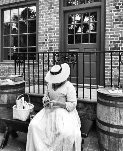 People And Places working on tapestry in days of old... Sitting Sewing Building Exterior Hat Window Woman Architecture Well-dressed Old Fashion Blackandwhite Black & White Solitude Williamsburg Virginia Monochrome Photography Handmade For You Second Acts Second Acts