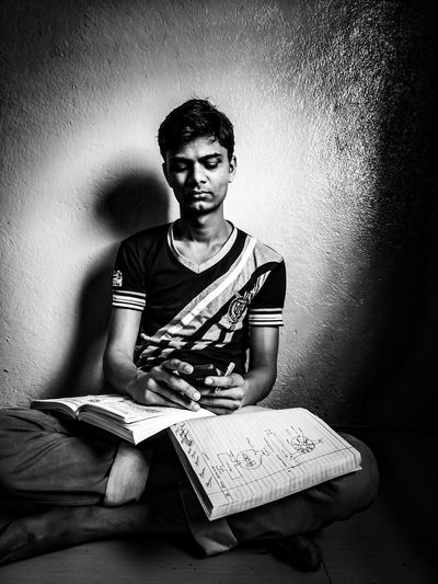 Studying in village Indoors  Traveling Home For The Holidays Indoors  Outdoors Nature Agriculture Monochrome Photography Place Of Worship Urban Skyline Waterfront Dome Architecture Tree Trunk Built Structure Adult Adults Only Day Indoors  One Person People Sitting Table Young Adult Close Up Technology