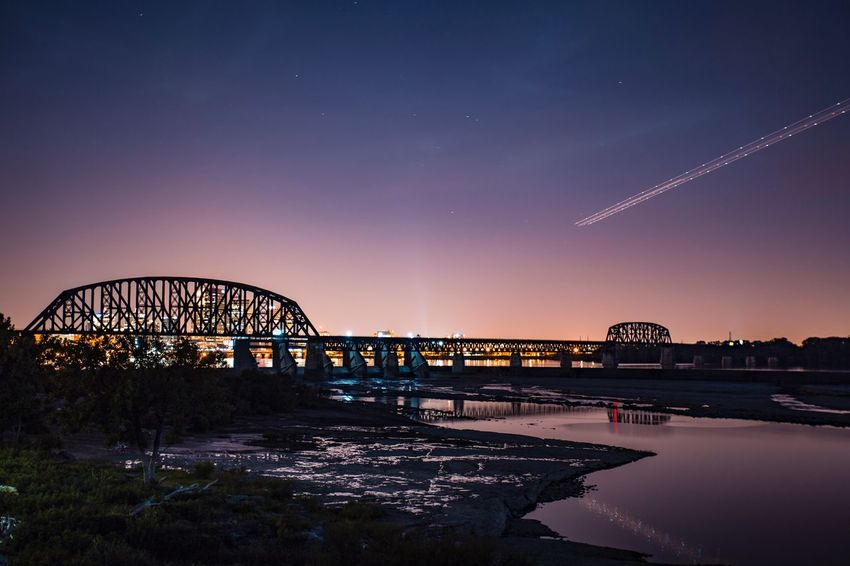 Hiking in the falls of the Ohio Architecture Sunset Water Tranquility Nature Scenics Connection Bridge - Man Made Structure Built Structure Bridge Engineering Arch River Arch Bridge Orange Color Railway Bridge Tranquil Scene Sky Atmosphere Journey (null)Summertime Louisville Louisville, Kentucky