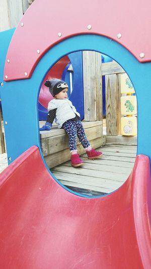 Full length of baby girl standing in playground