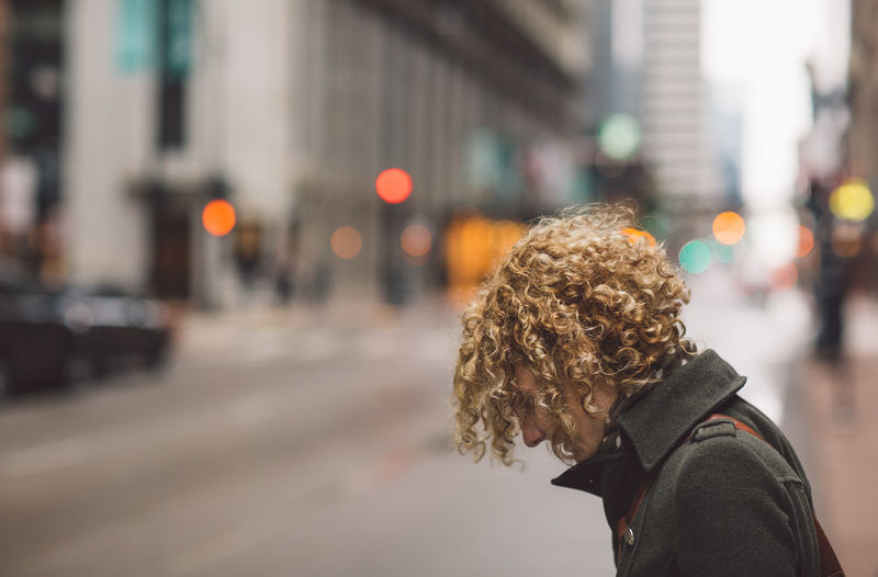 Curly Hair Girl City Street Architecture One Person Building Exterior Focus On Foreground City Life Built Structure Headshot Side View Real People Portrait Lifestyles Young Adult Transportation Incidental People City Street Hair Hairstyle Outdoors Profile View