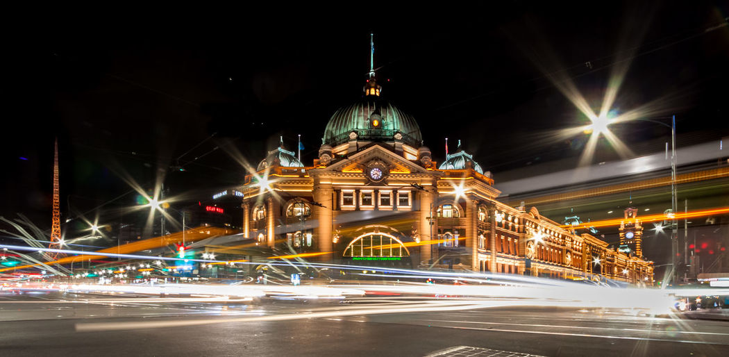 Light trails from passing transport in front of Flinders Street Station Architecture Blurred Motion Building Exterior Built Structure City Flinders Street Station Government Illuminated Lens Flare Light Trail Long Exposure Motion Night No People Outdoors Road Sky Speed Street Tourism Transportation Travel Travel Destinations