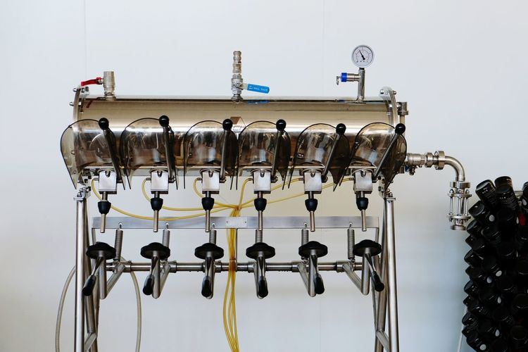 Close-up of bottle filling machine in industry