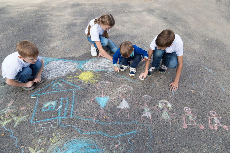 children draw in crayon on asphalt Happiness Friendship Doodle Sketching Game Chalking Pavement Colorful Activity Creative Playground Happy Lifestyle Playing Coloring Painting Leisure Activity Leisure Education Artist Sun House Cute Play People Image Draw Art Outside Street Sidewalk Close Up Color Fun Outdoor Day Summer Crayons Children Family Chalk Drawing Asphalt Creativity Child Childhood Boy Girl Teenager Teen